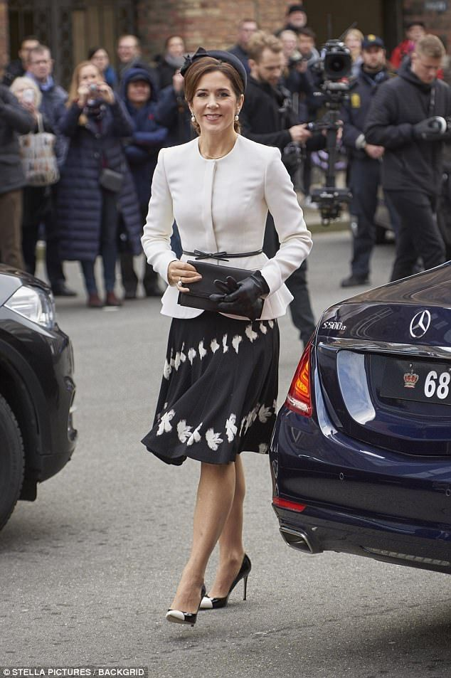 Princess Mary (pictured) wowed onlookers with her chic and put together black and white outfit as the Danish Royal Family attended the 500th Reformation Anniversary Ceremony