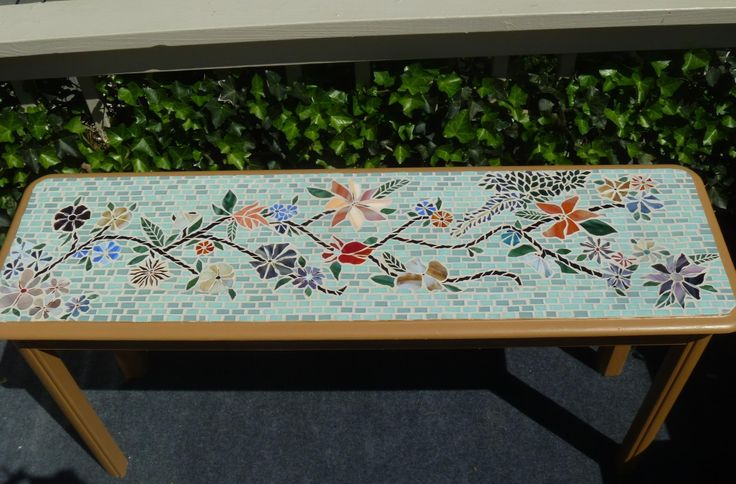 Mosaic table. Rectangular long this shape. Love it
