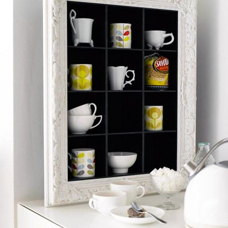 Cubby shelves with an ornate frame for display.