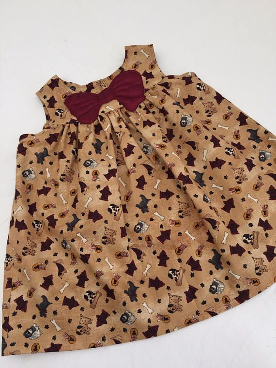 Baby dress size 6  9 month. With cute dogs meatbones and a