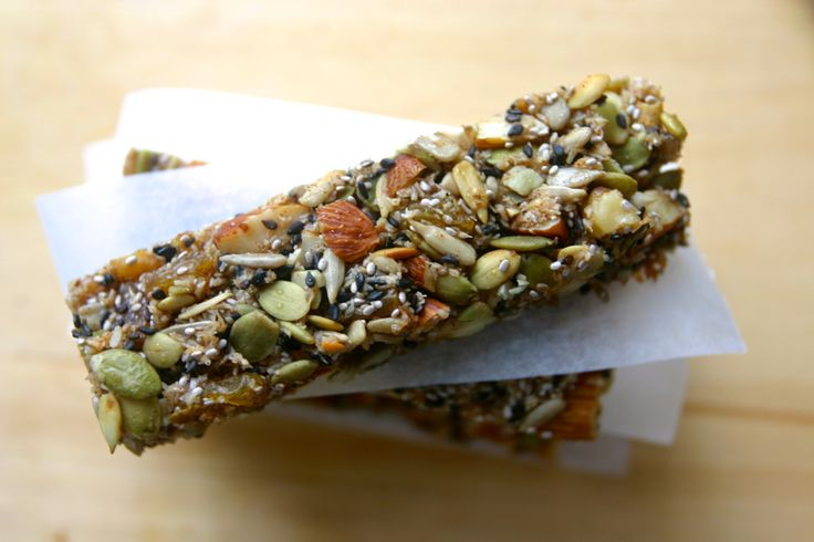 "#Paleo ""granola"" Bars #GF 1 cup almonds ½ cup walnuts, pecans, or your favorite nut ½ cup shredded unsweetened coconut 1/3 cup golden raisins 2/3 cup pumpkin seeds 2/3  cup sunflower seeds 3 Tbsp sesame seeds 3 Tbsp chia seeds 1 Tbsp orange zest 2 Tbsp coconut oil, melted 1/2 cup honey"