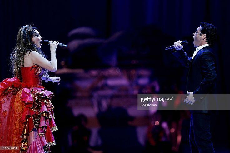 Singer Sarah Brightman and Opera singer Mario Frangoulis perform at Madison Square Garden on November 23, 2008 in New York City.