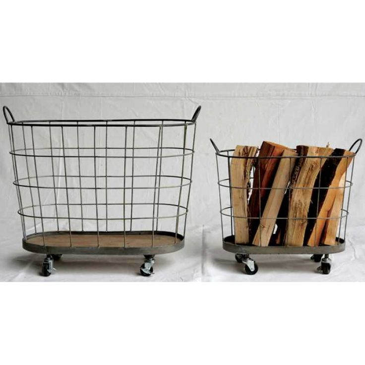 This metal wire rolling basket features two handles and a wood bottom, perfect for adding vintage industrial style to any room whether holding pillows, throws, or firewood.