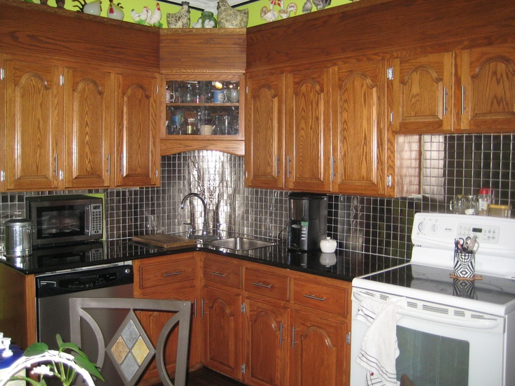 Gutted out the kitchen in 2011.We kept only the cupboards.I learned how to tile on the net and am now proud to show off my stainless steel backsplash that I did myself.(I have a stainless stove noww too) :)