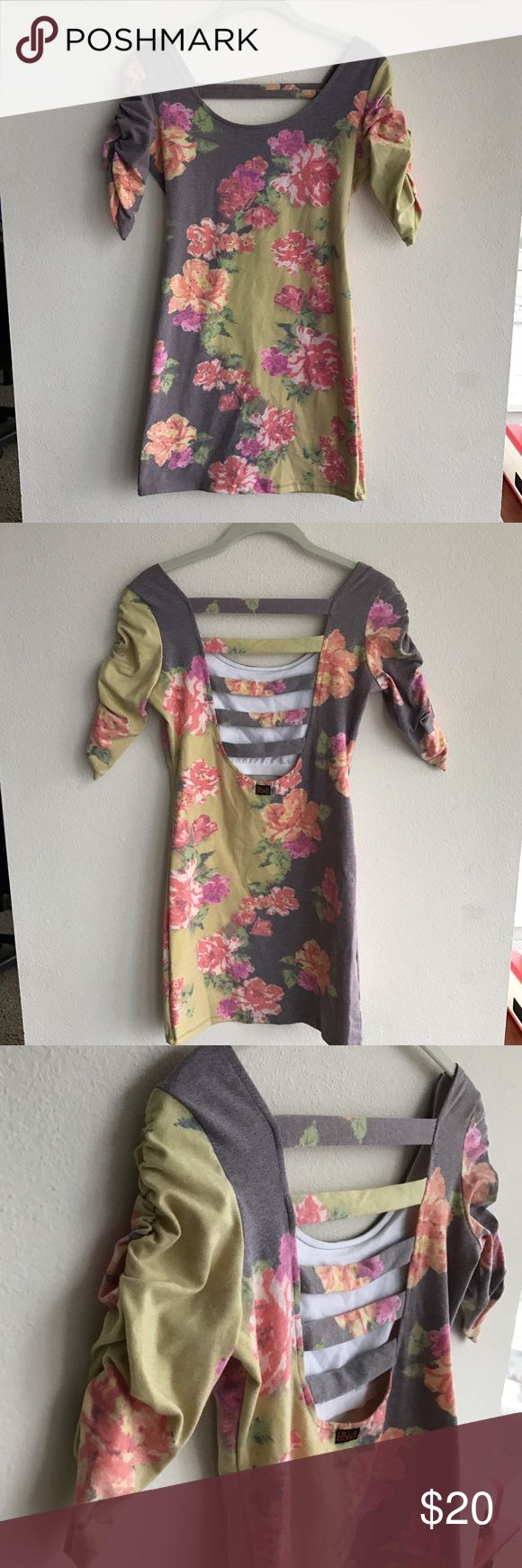 Floral Bodycon Dress Cute floral patterned dress with awesome back details. Scrunched mid length sleeves. Worn once. From Billabongs Designer Closet collection. Billabong Dresses Mini