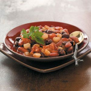 Southwestern Baked Beans Recipe -Three kinds of beans and a host of seasonings make this version of baked beans a winner. Southwest flavors dominate in this dish that's perfect with grilled chicken. Leslie Adams - Springfield, Missouri
