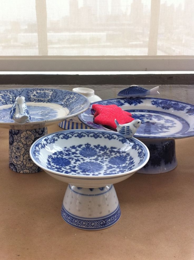 DIY!! Make your own 1950's-looking footed compotes for a table-setting story by hot-gluing a simple blue and white plate onto an inverted blue and white bowl or cup.