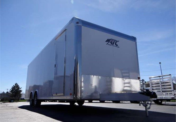 Enclosed 8.5' x 24' Polar White Car Hauling Trailer Built By ATC. This Is a Very Nice 8.5' x 24' Car Hauler Trailer with a Rear Ramp Door, a Side Door, Screwless Exterior and 7' Inside Height. $11,095 Any applicable fees and taxes are extra. Ref # HE208380   Advantage Trailers and Hitches