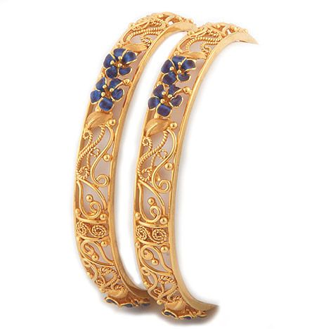 Gold bangle with blue enamel paint - love the design