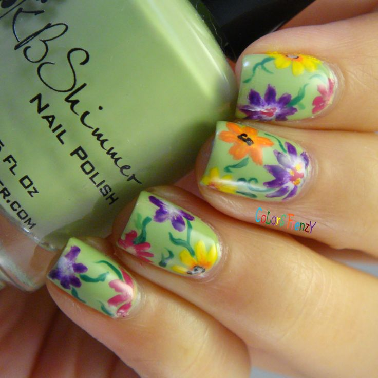 Mint base coat with purple, orange, yellow and pink flower nail art. A little Victorian and a whole lot of pretty! #nailart #naildesign #flowers
