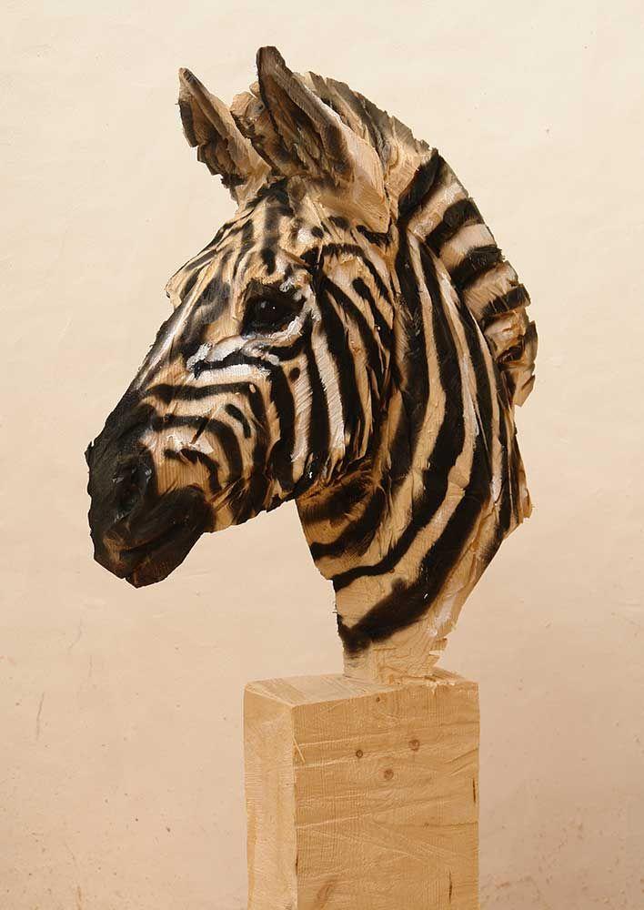 'Zebra' wooden sculpture made by a chainsaw. Artist: Jurgen Lingl Rebetez