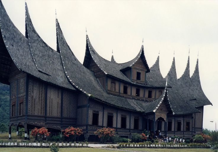 Pagaruyung Palace, West Sumatera.  Rumah gadang are the traditional houses of the Minangkabau. With the Minangkabau society being matrilineal, the house is owned by the women of the family who live there.  The houses have dramatic curved roof structure with multi-tiered, upswept gables, inspired some building in Europe, such as House of Five Senses in Netherland.