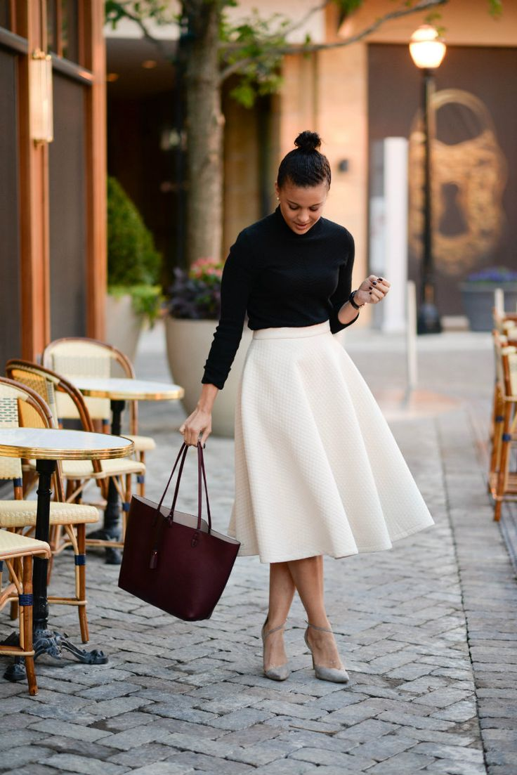black turtleneck tucked into white high-waist midi skirt