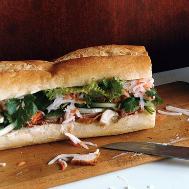 Bahn Mi chicken sandwich. Freshly picked veggies with rotisserie chicken, liverwurst, jalapenos, cilantro, thinly sliced onions, lettuce, and mayo. Serve with a fruit salad, and summertime dinner is DONE.