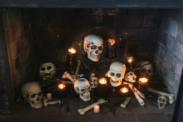 Fireplace Scape ~ I did this and used flameless LED candles which gave off a nice glow and looked great. I am going to do this every Halloween.