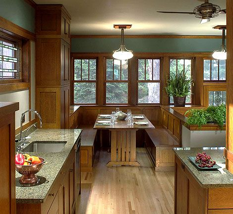 Example of Craftsman millwork design in a modern or updated kitchen/breakfast nook. Wood trim headers and a continuous line of paned windows as well as the small details such as the leaded window over the sink are classic craftsman beauty.