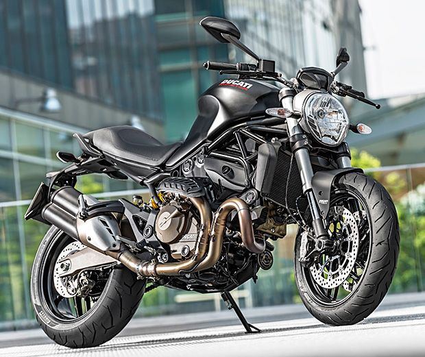 Ducati Monster 821.  It looks a lot like its big brother, the 1200S, but Ducati's newest Monster is a bit smaller; powered by a more compact water-cooled, 821-CC Testastretta 11° V-twin. It also got 8-level traction control & ABS from its big bro and will be offered 2 models: the regular 821 in red & white & the blacked-out 821 Dark.