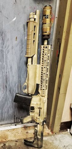 AR-15 5.56/.223 with a 12G Shotgun