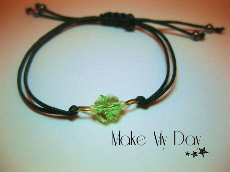 The most stylish macrame bracelete detailed eith Swarovski charm.