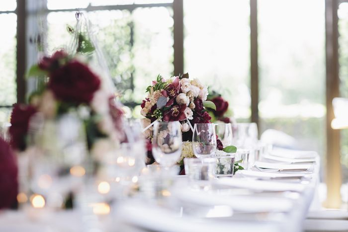 table decorations, wedding, colours, peonies, blood red, burgundy, pink, flowers, inspiration, glassware, geometric, diamond, #arch #weddingarch #wedding #styling #weddingflowers, marriage, green, spring Styling by The Style Co, Melbourne, Circa, , shoes, photography by Leo Farrell, venue Circa the Deck St Kilda