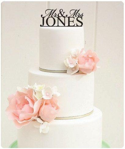 """6"""" Custom Last Names Mr and Mrs Monogram Wedding Cake Topper. $32.00, via Etsy."""
