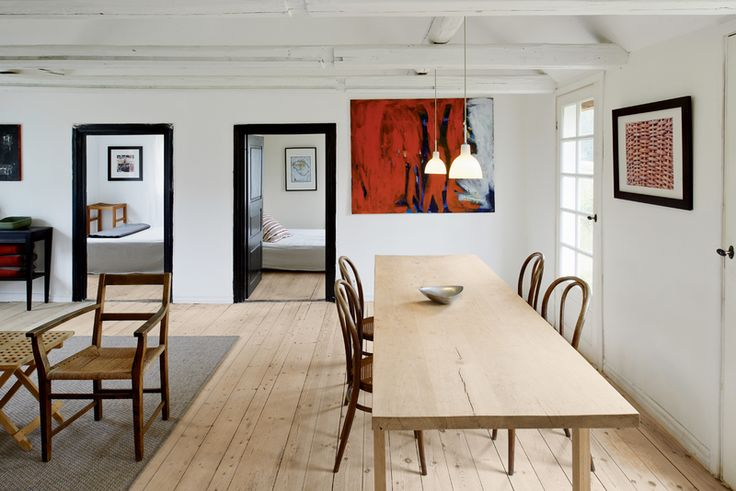 One of the few designer pieces in the home, a set of four Michael Thonet coffee house chairs,from 1859, offer a simple seating solution. The dining table, designed by Odgård, was built from a 109-year-old oak tree, which was harvested and milled locally.