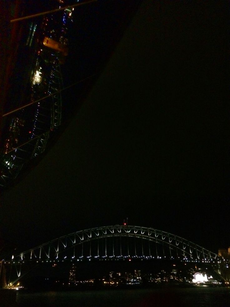 Sydney harbour bridge at night from the SOH (eastern sail)