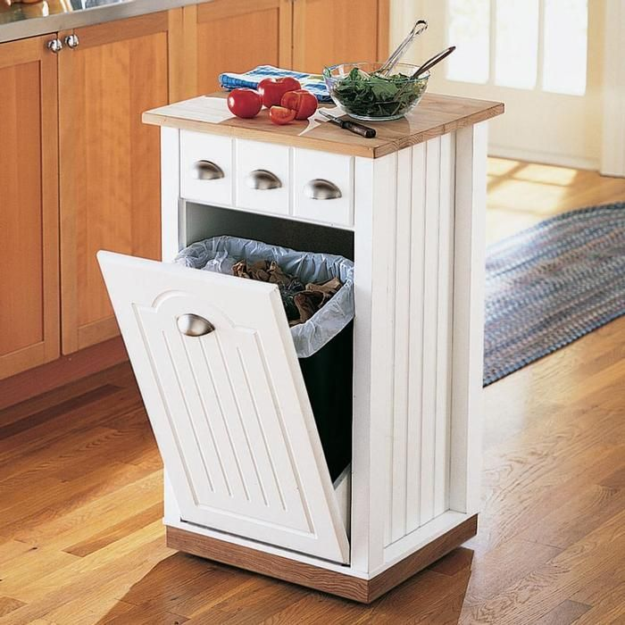 Rolling Kitchen Island. I HATE having trash containers out to be seen. This is a great idea for tight spaces!