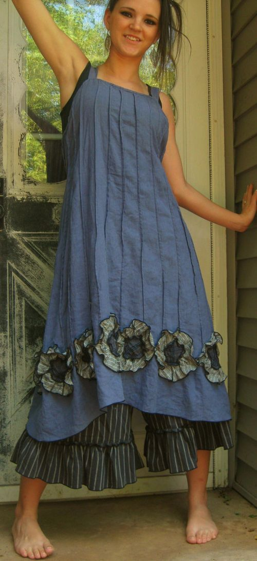 """Maybe not the big flowers, but I like the idea of the vertical seaming and how it stops before the bottom of the dress to create a """"ruffle"""""""