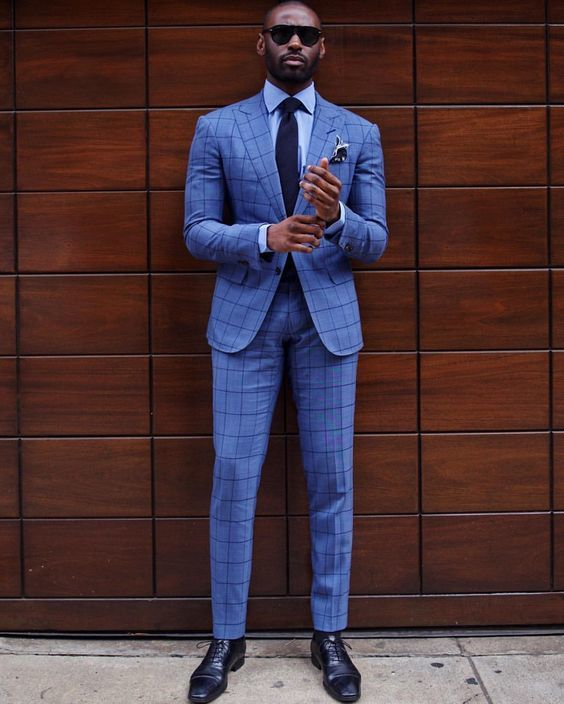 Consider pairing a blue check suit with a baby blue classic shirt for a sharp classy look. Channel your inner Ryan Gosling and make navy leather oxford shoes your footwear choice to class up your look.   Shop this look on Lookastic: https://lookastic.com/men/looks/suit-dress-shirt-oxford-shoes/20939   — Light Blue Dress Shirt  — Navy Pocket Square  — Navy Tie  — Blue Check Suit  — Navy Leather Oxford Shoes