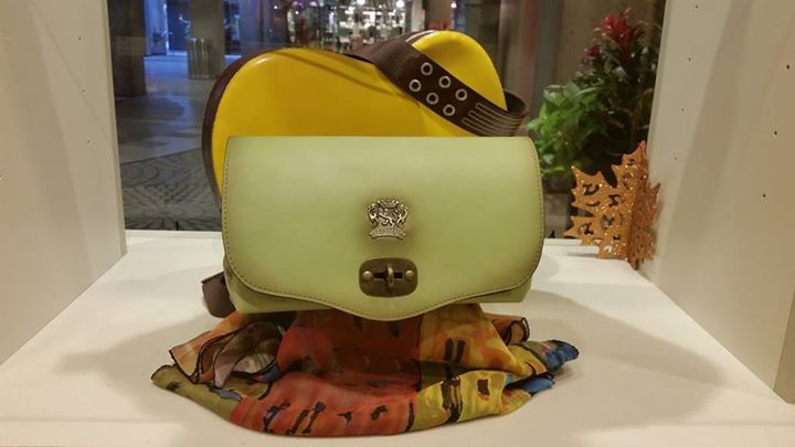 Gorgeous light green Pratesi shoulder bag comes with an adorable matching green light inside to help you find your small items. This one of a kind bag can be yours for $239.