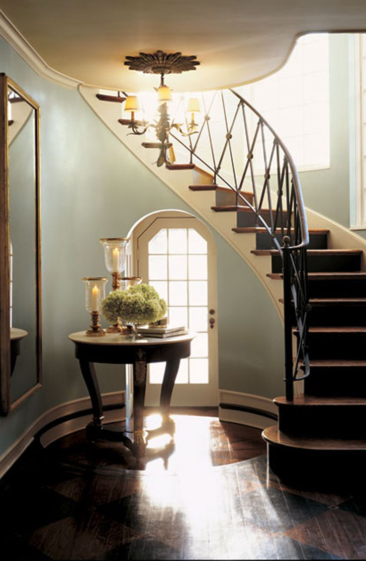 A beautifully crafted staircase reflecting soft Ralph Lauren Paint and the setting sun.