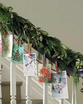 DIY Decor - evergreen garland and ribbon, attach Christmas cards to ribbon using clothespins that have been decorated with gift wrap scraps glued to same - how-to @Martha Stewart Living