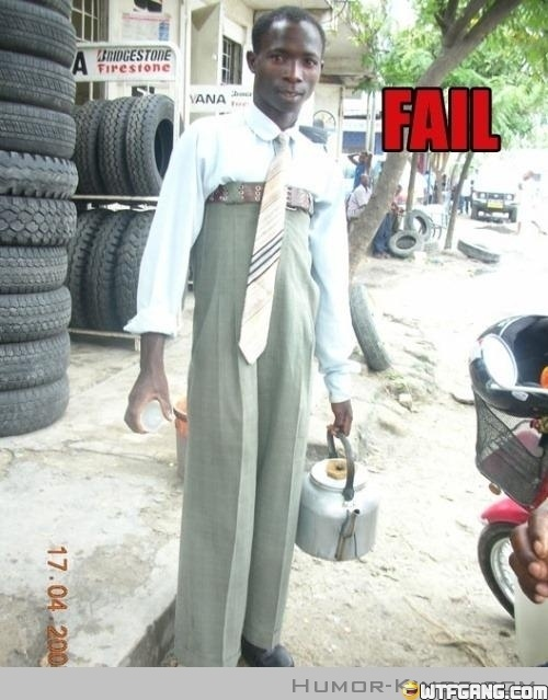 """Fashion Fail... Make sure your dress pants aren't sitting to high above your waist. You want to look professional, and although he is wearing an acceptable outfit, he is definitely not wearing it """"right."""""""