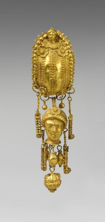 Earring with pendants and female head. Period: Hellenistic. Date: 3rd century B.C. Culture: Etruscan. Medium: Gold, silver.   © 2000–2015 The Metropolitan Museum of Art.
