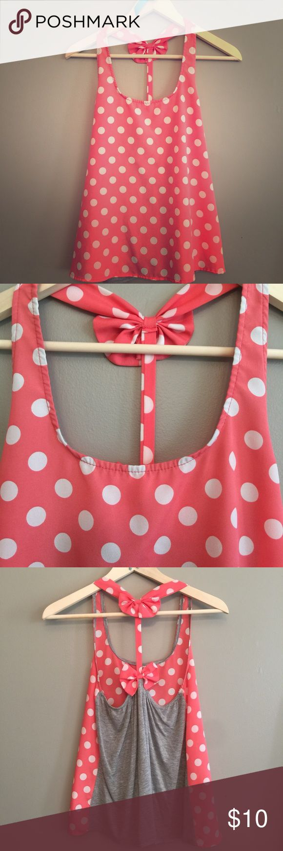 Polka dot bow tank top Super cute top in excellent condition. Love polka dots and the bow on the back is just too cute. Beautiful coral / pink color. Similar to one I saw from stitch fix! Size small. Brand is Bejewel. Tops Tank Tops