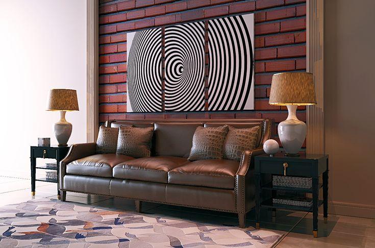 Оформление диванной зоны классического кабинета требовало строгих тонов и правильных линий, но не должно навевать скуку. Кожаный диван отлично расположился на фоне фотообоев с текстурой кирпичной кладки. Логическим завершением композиции стала разделённая на три части геометрическая трансформация, выполненная в чёрно-белой гамме и отпечатанная на холсте.
