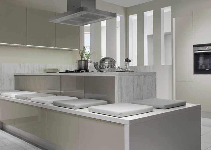 Gray high gloss surfaces complete the look of this modernized kitchen design. Achieve this trending look with RAUVISIO brilliant Cubanite 5338B!