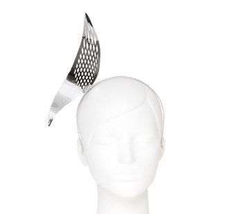 Silver titanium metallic geometric feather with cut outs on a matching headband by Studio ANISS for all seasons and fashion events easy to wear