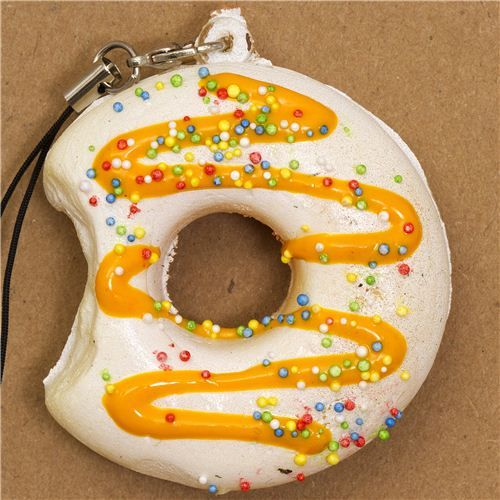 white donut squishy charm with colourful sprinkles