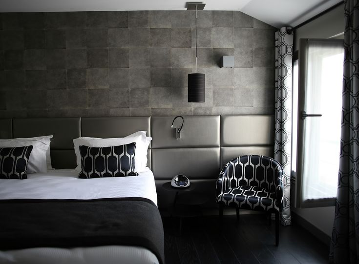 faux grey stone wall bedroom black and white chair patterns curtains