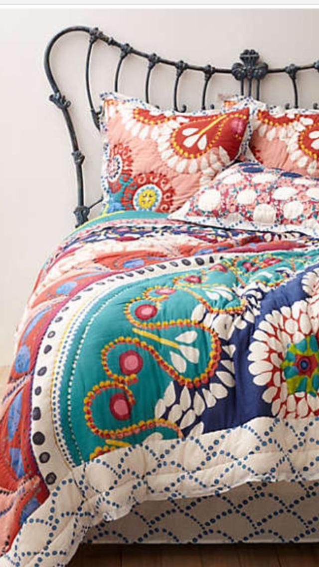 Love the Art Nouveau headboard and the colorful spread; for the teenage girl's room that I never got to have....