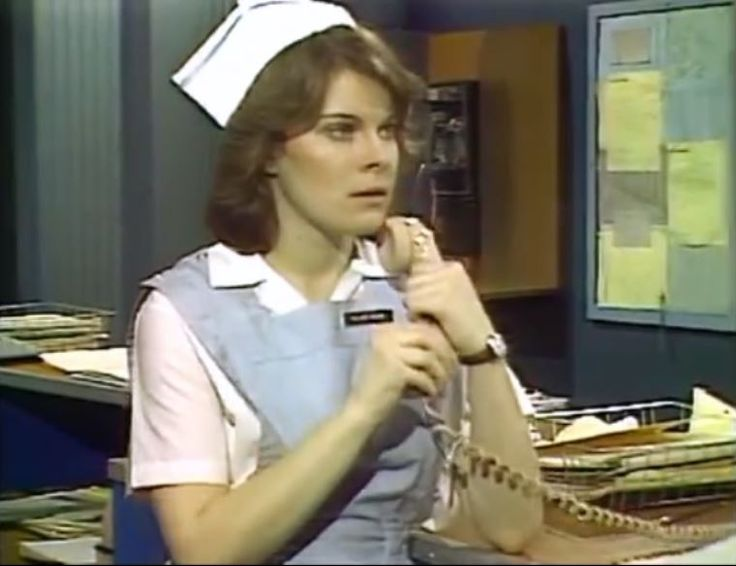 APRIL 1980--Hilary Bauer (MARSHA CLARK) has a concerned look on her face when she finds out the phone call is for Bert Bauer in regards to the whereabouts of her sons.