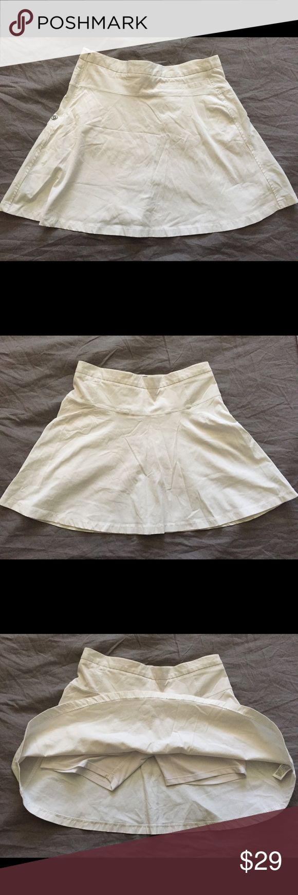 """Women's workout skort by Lija White women's mid-length (about 15"""") tennis skirt with built in spandex short. Perfect for any type of exercise since it's very light weight and breathable. Has a side zipper.  70% nylon 27% cotton 3% elastane Shorts Skorts"""