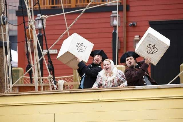 Boston Tea Party Museum reenactment of throwing tea overboard from the British East India Company in Boston Mass.
