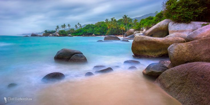 Parque Tayrona, Colombia  A national park on the northern Caribbean coast of Colombia, boasts some absolutely stunning beach scenes with unique boulders littering the coastline.  #Colombia #SouthAmerica #SeascapePhotography #LongExposure