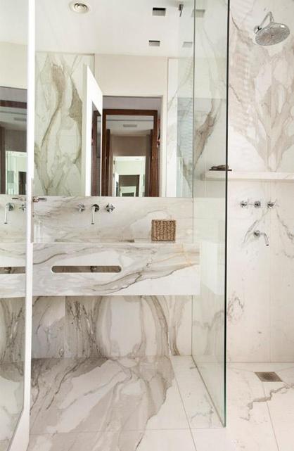 Martin Gomez Marble bathroom with glass shower door