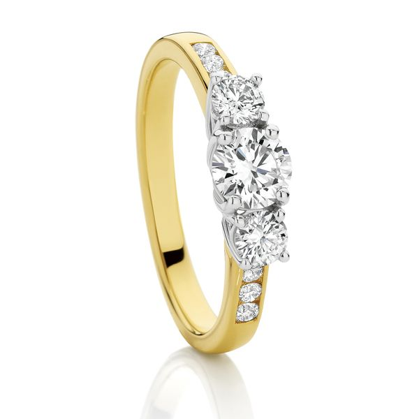 Yellow gold 3 stone with diamond shoulders 0.75ct