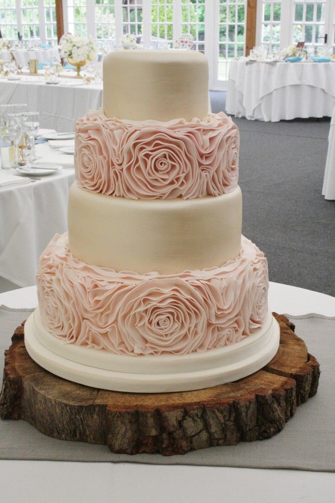 www.sylviaskitchen.co.uk Four Tier Wedding Cake at Broyle Place, Ringmer, Lewes, East Sussex.  Base and Tier Two finished with blush pink sugar ruffles, Tiers 1 and 3 finished in a soft gold metallic lustre.