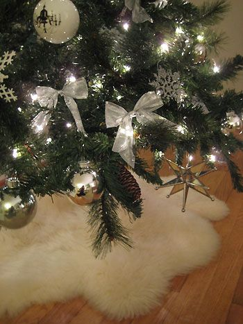 grabbed 2 faux sheepskin rugs at ikea today for a fluffy christmas tree skirt a la @Sherry @ Young House Love this year!!